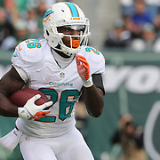 Lamar Miller, Miami Dolphins, in action during the New York Jets Vs Miami Dolphins  NFL American Football game at MetLife Stadium, East Rutherford, NJ, USA. 1st December 2013. Photo Tim Clayton