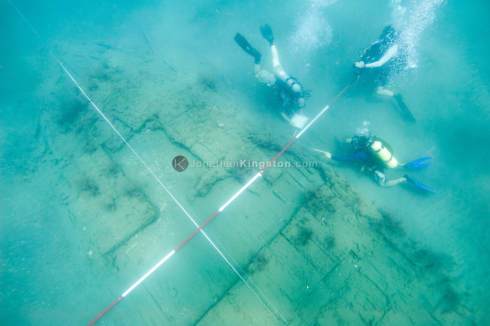 Archaeologists Juan Martin and Christopher Morris mapping the Encarnación, a 17th century shipwreck discovered on an expedition looking for Henry Morgan's lost fleet of 1671 in Panama.