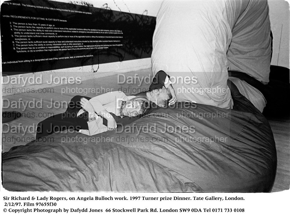 Sir Richard & Lady Rogers, on Angela Bulloch work. 1997 Turner prize Dinner. Tate Gallery, London. 2/12/97. Film 97655f30<br />