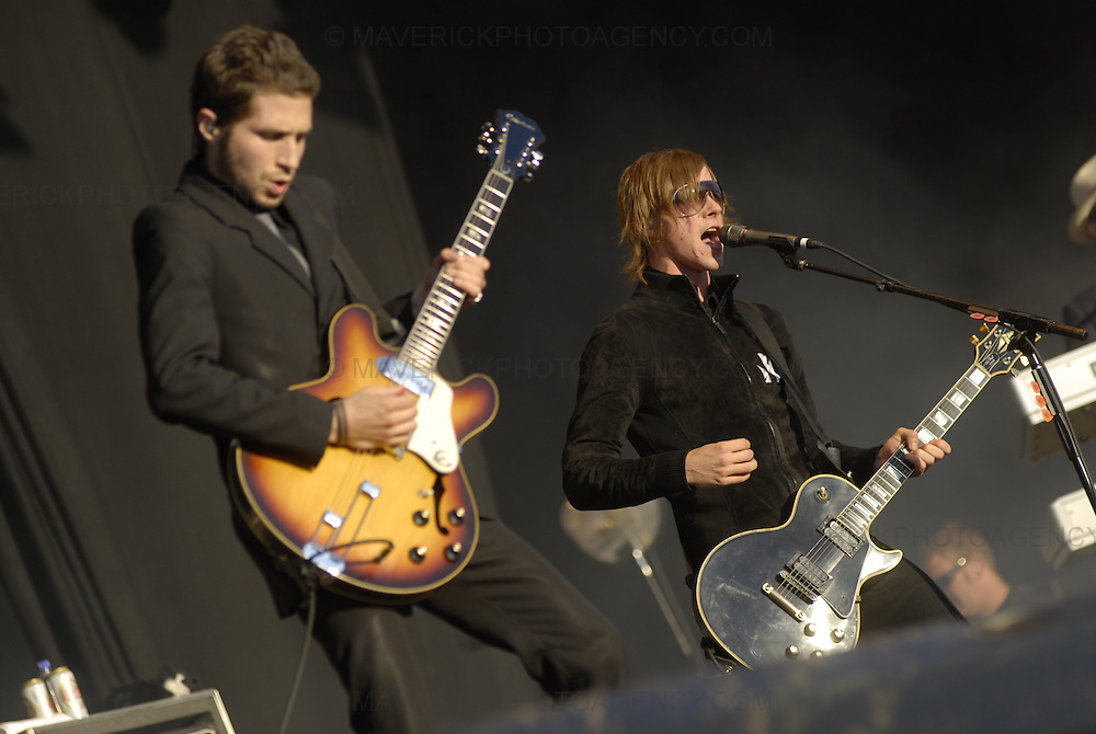 BALADO, KINROSS, SCOTLAND - JULY 8th 2007: Interpol perform live at T in the Park 2007.  Pictured left guitarist Daniel Kessler and right singer Paul Banks.