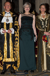 © Licensed to London News Pictures. 13/11/2017. London, UK. Lord Mayor CHARLES BOWMAN, British Prime Minister THERESA MAY and SAMANTHA BOWMAN attend the annual Lord Mayor's Banquet at Guildhall. Photo credit: Ray Tang/LNP