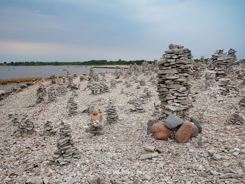 Stones piled up as tower at beach. Saaremaa stony coast by Baltic Sea, Estonia.