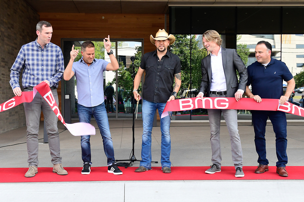Jason Aldean helps cut the ribbon on BMG Nashvilles new offices on September 10, 2019 in Nashville, TN