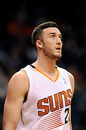 Dec 23, 2013; Phoenix, AZ, USA; Phoenix Suns forward Miles Plumlee (22) reacts on the court in the first half against the Los Angeles Lakers at US Airways Center.  The Suns won 117-90. Mandatory Credit: Jennifer Stewart-USA TODAY Sports