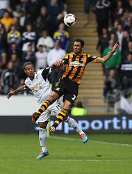 Hull's Ahmed Elmohamady wins an aerial duel with Swansea's Wayne Routledge - Photo mandatory by-line: Matt Bunn/JMP - Tel: Mobile: 07966 386802 05/04/2014 - SPORT - FOOTBALL - KC Stadium - Hull - Hull City v Swansea City- Barclays Premiership