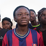 Amazones women football team players. Girls wear Barcelona, Chelsie, Milan or Real Madrid shirts, sold cheap everywhere. Most of them don't have football shoes, all of them dream to become a star