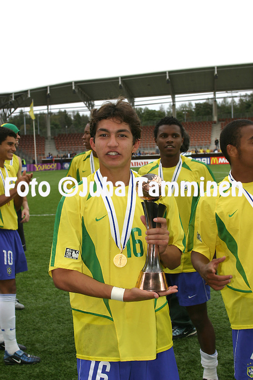 30.08.2003, T??l? Stadium, Helsinki, Finland.FIFA U-17 World Championship - Finland 2003.Match 32: Final - Brazil v Spain.Juliano of Brazil with the trophy and gold medal.Full name: Juliano Mineiro Fernandes.©Juha Tamminen
