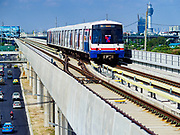 06 DECEMBER 2018 - SAMUT PRAKAN, THAILAND:  A BTS Skytrain comes into Kheha station on the newly opened expansion of the line. The 12.6 kilometer (7.8 miles) east extension of the Sukhumvit Line of the Bangkok BTS Skytrain goes into Samut Prakan, a town east of Bangkok.  The system is now 51 kilometers long (32 miles), including the 12.6 kilometer extension that opened December 06. About 900,000 people per day use the BTS.     PHOTO BY JACK KURTZ