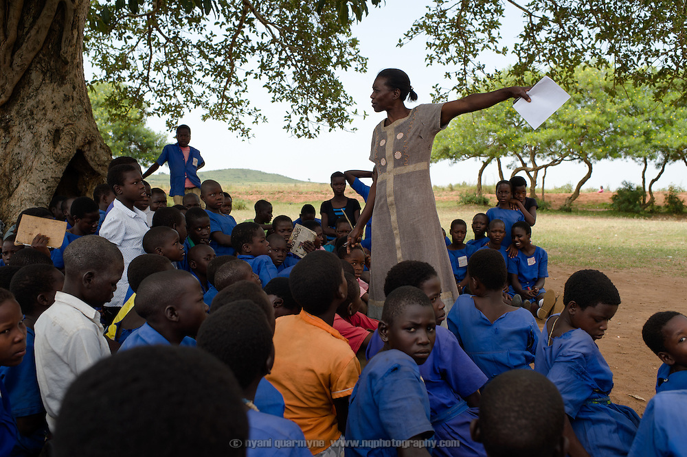 Anna Godliver Okurut, Head Teacher delivering a very candid and open presentation on Menstrual Hygiene Management at Aputiri Primary School in Eastern Uganda on 31 July 2014.