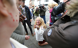 © Licensed to London News Pictures. 29/04/2017. Hartlepool UK. A UKIP supporter kneeling on the floor with blood on her face after a fight breaks out between Pro EU campaigners Northe East for Europe and UKIP party supporters in Hartlepool, County Durham, before UKIP leader Paul Nuttall heads out on the campaign trail. Photo credit: Andrew McCaren/LNP