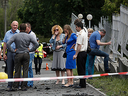 June 27, 2017 - Kiev, Ukraine - Relatives of killed by a car bomb is seen at a site of murder in Kyiv, Ukraine, June 27, 2017. The commander of Ukraine's military intelligence special ops unit colonel Maksym Shapoval was killed by a bomb attached to the bottom of his vehicle in central Kyiv on Tuesday, June 27. Police investigate the incident as an ''act of terrorism' (Credit Image: © Sergii Kharchenko/NurPhoto via ZUMA Press)