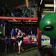 An 'alien' toy in the last afternoon light as a family head home after the May Fair at Saint Mark's Church, New Canaan, Connecticut, USA. 12th May 2012. Photo Tim Clayton