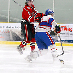 TORONTO, ON - Feb 16 : Ontario Junior Hockey League Game Action between the Milton Ice Hawks and the Toronto Jr. Canadiens, Shane Bennett #18 of the Milton Ice Hawks Hockey Club tries to get past Aaron Thow #4 of the Toronto Jr. Canadiens Hockey Club during second period game action.<br /> (Photo by Brian Watts / OJHL Images)
