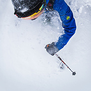 Tyler Hatcher skis Cascade powder during winter from a POV camera angle.