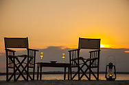 Set up for drinks at sunset, Zanzibar, Tanzania. http://www.gettyimages.com/detail/photo/beach-table-and-chairs-for-two-at-sunset-royalty-free-image/182986707