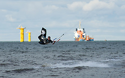 © Licensed to London News Pictures. 05/10/2012..Redcar Beach, Cleveland, England..The UK's best kitesurfers head to Redcar in Cleveland this weekend for the 6th round of the British Kite surfing National Tour...The event, called 'Kitetastic', will take place on Friday 5 to Sunday 7 October, where over 100 competitors will go head to head in a number of disciplines propelled by powerful kites...Along with the kite surfing other land based events such as kite buggy and kite landboard were held...The three-day kiting festival is taking place at Majuba Beach, Redcar in North Yorkshire, a spot famed for its consistent winds and great expanse of sand...Photo credit : Ian Forsyth/LNP