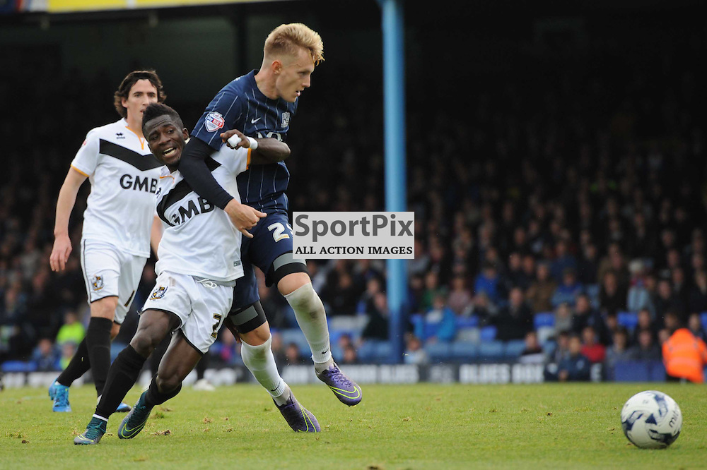 Southends Joe Pigott and Port Vales Enoch Andoh in action during the Southend v Port Vale game in Sky Bet League 1 on the 10th October 2015