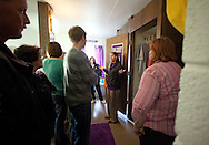 Trinity Renchin (second on right), student ambassador, leads a tour of prospective students and their parents during an open house in a freshman dorm room at Waldorf College in Forest City, Iowa on Saturday, May 14, 2011.