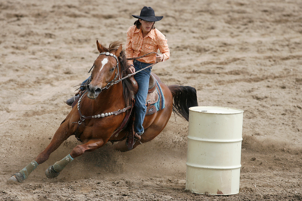 062109-Evergreen, Colo.-barrelracing-Mary Cecelia-Tharp from Ault, CO rounds the last barrel during the 2009 Evergreen Rodeo PRCA Barrel Racing Competition Sunday, June 21, 2009 at The Evergreen Rodeo Grounds..Photo By Matthew Jonas/Evergreen Newspapers/Photo Editor