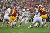 03 November 2012: Quarterback (8) Marcus Mariota of the Oregon Ducks runs the ball against the USC Trojans during the first half of Oregon's  62-51victory over USC at the Los Angeles Memorial Coliseum in Los Angeles, CA.