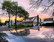 Garden City Park, New York, U.S. May 2, 2020. During my social distancing visit to Bob, we see a colorful sunset from his from yard.