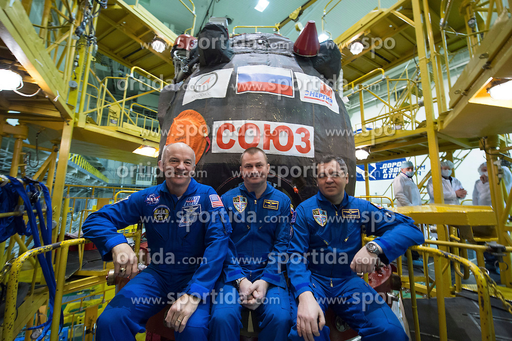 File image dated 04 Mar 2016.In the Integration Facility at the Baikonur Cosmodrome in Kazakhstan, Expedition 47-48 crewmembers Jeff Williams of NASA (left) and Alexey Ovchinin (center) and Oleg Skripochka (right) of Roscosmos pose for pictures March 4 in front of their Soyuz TMA-20M spacecraft in their Russian Sokol launch and entry suits during final pre-launch training. The trio will launch March 19, Kazakh time, for a six-month mission on the International Space Station. Flight Engineer Jeff Williams of NASA - who is a grandfather of three and 58 years old - is set to break fellow US astronaut Scott Kelly&rsquo;s record of the American with the most cumulative days in space. Kelly returned from his year in space with a total of 520 days in space, but Williams will return from this mission with a total of 534 days. EXPA Pictures &copy; 2016, PhotoCredit: EXPA/ Photoshot/ Atlas Photo Archive/ROSCOSMOS/NASA<br /> <br /> *****ATTENTION - for AUT, SLO, CRO, SRB, BIH, MAZ, SUI only*****