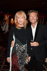WARREN TODD and SUE VANNER at a party to celebrate the publication of 'Passion for Life' by Joan Collins held at No41 The Westbury Hotel, Mayfair, London on21st October 2013.