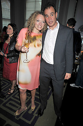STEPHANIE THEOBOLD and JAKE ARNOTT at a party to celebrate the publication of Stephanie Theobold's book 'A Partial Indulgence' held at the Langham Hotel, Portland Place, London on 21st April 2009.