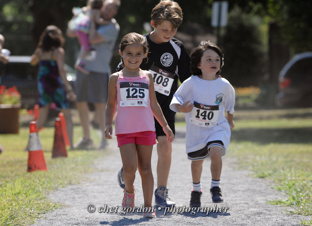 Young runners approach the finish line in the Children's Fun Run during the Greenwood Lake Inaugural 5K Run in Greenwood Lake, NY on Saturday, August 9, 2014.  © Chet Gordon/THE IMAGE WORKS