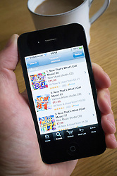 Using an iPhone 4G smart phone to buy Music albums at Amazon.com online store