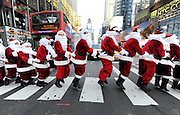 Santa Clauses bunny hop through Times Square as they deliver holiday PEEPS and spread cheer, Wednesday, Dec. 4, 2013, in New York. (Photo by Diane Bondareff/Invision for PEEPS/AP Images)