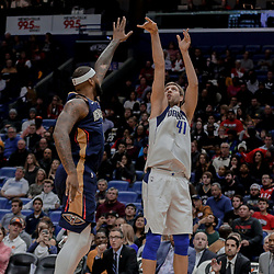 Dec 29, 2017; New Orleans, LA, USA; Dallas Mavericks forward Dirk Nowitzki (41) shoots over New Orleans Pelicans center DeMarcus Cousins (0) during the first quarter at the Smoothie King Center. Mandatory Credit: Derick E. Hingle-USA TODAY Sports
