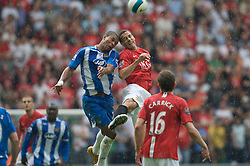 WIGAN, ENGLAND - Sunday, May 11, 2008: Manchester United's Rio Ferdinand and Wigan Athletic's Marcus Bent during the final Premiership match of the season at the JJB Stadium. (Photo by David Rawcliffe/Propaganda)