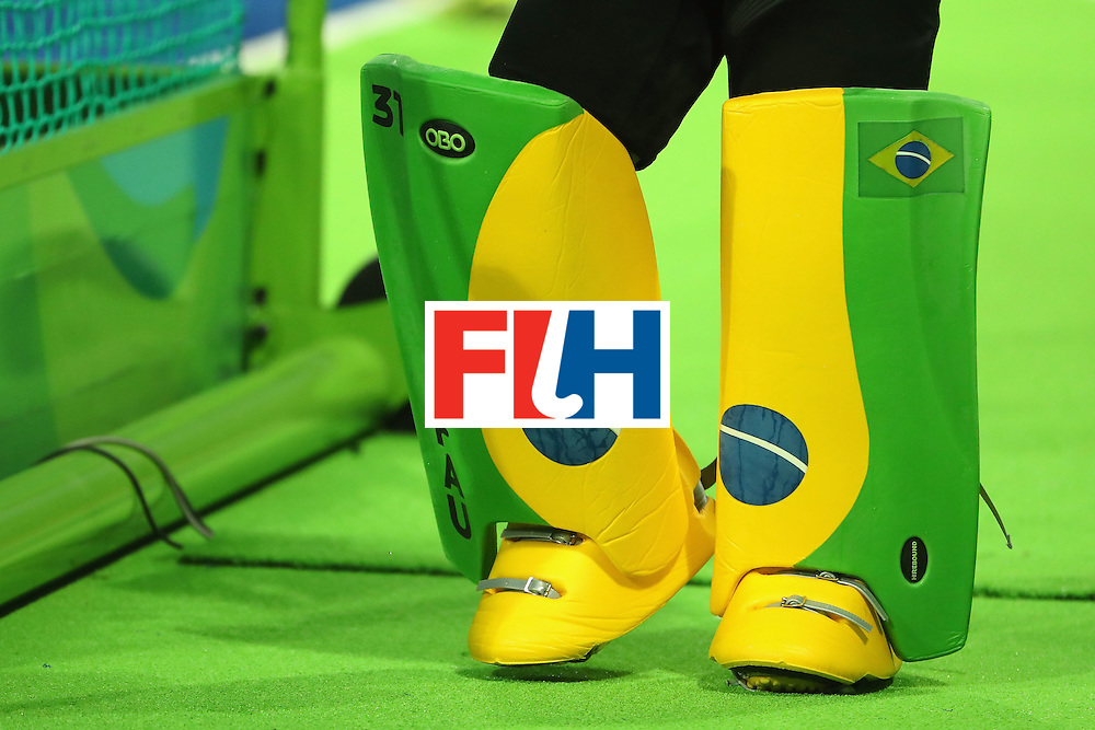 RIO DE JANEIRO, BRAZIL - AUGUST 09:  Detail of pads worn by goalkeeper Rodrigo Faustino #31 of Brazil as he warms up before the hockey game against Great Britain on Day 4 of the Rio 2016 Olympic Games at the Olympic Hockey Centre on August 9, 2016 in Rio de Janeiro, Brazil.  (Photo by Christian Petersen/Getty Images)