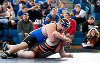 Winnisquam's Tyler Labonte attempts to pin Newport's Ethan Beattie in the 285 lb weight class round at the High School Wrestling Tournament at Winnisquam Regional on Saturday.  (Karen Bobotas/for the Concord Monitor)