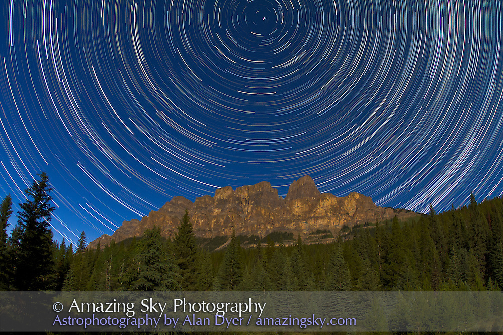 Circumpolar stars trails over Castle Mountain in Banff, Alberta. Taken July 23, 2010 from Castle Cliffs viewpoint on Bow Valley Parkway. A stack of 160 25-second exposures with Canon 15mm lens at f/4 and Canon 7D camera at ISO 640. Taken over 2 hours. Full Moon light provided the illumination.