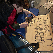 A protestor makes his mark.The London Stock Exchange was attempted occypied in solidarity with Occupy Wall in Street in New York and in protest againts the economic climate, blamed by many on the banks. Police managed to keep people away fro the Patornoster Sqaure and the Stcok Exchange and thousands of protestors stayid in St. Paul's Square, outside St Paul's Cathedral. Many camped getting ready to spend the night in the square.