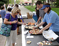 W. g. Grinders sets out samples during the 21st annual The Taste in the Lincoln Park Commons area at the Fraze Pavilion, Thursday, September 3, 2009.