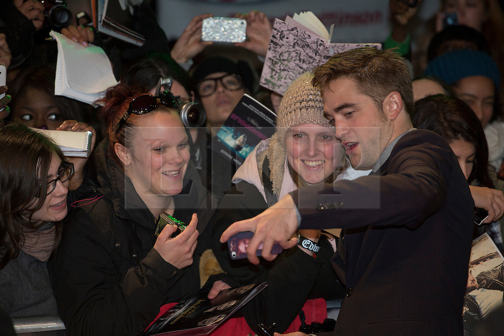 © licensed to London News Pictures. London, UK 14/11/2012. Robert Pattinson taking pictures with his fans on the red carpet at the UK premiere of the The Twilight Saga: Breaking Dawn Part Two in Leicester Square, London. Photo credit: Tolga Akmen/LNP