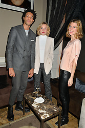 Left to right, CHARLIE CASELY-HAYFORD, SOPHIE ASHBY and SUSANNA WARREN at the Tatler Little Black Book Party held at Home House Private Member's Club, Portman Square, London supported by CARAT on 6th November 2014.