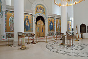 Narthex of the Cathedrale de la Sainte-Trinite de Paris, or Holy Trinity Cathedral of the Russian Orthodox Church, built 2013-16, on Quai Branly, in the 7th arrondissement of Paris, France. This room is plastered and lined with frescoes on a gold background, centred around the iconostasis. There are also manoualia, large brass candle holders, and a horos, a gold filigree chandelier. The cathedral is part of a complex with the Centre Spirituel et Culturel Orthodoxe Russe, promoting Russian cultural religious heritage. Picture by Manuel Cohen