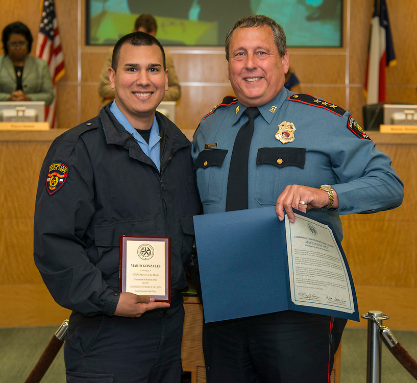 Houston ISD employee of the month Officer Mario Gonzales and Chief Robert Mock pose for a photograph during the Board of Trustees meeting, April 9, 2015.