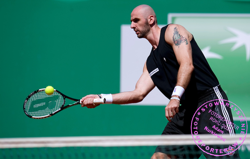 MARCIN GORTAT (POLAND) NBA BASKETBALL PALYER WHILE EXHIBITION TENNIS MATCH DURING DAY 5 OF THE MEN'S SINGLES TOURNAMENT BNP PARIBAS POLISH OPEN AT TENNIS CLUB IN SOPOT, POLAND...POLAND, SOPOT , JULY 15, 2011..( PHOTO BY ADAM NURKIEWICZ / MEDIASPORT )..PICTURE ALSO AVAIBLE IN RAW OR TIFF FORMAT ON SPECIAL REQUEST.