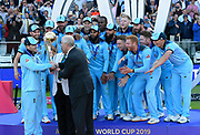 England are Champions - Eoin Morgan of England is presented the the Cricket World Cup trophy by HRH Prince Andrew the Duke of York during the ICC Cricket World Cup 2019 Final match between New Zealand and England at Lord's Cricket Ground, St John's Wood, United Kingdom on 14 July 2019.