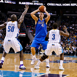 November 17, 2010; New Orleans, LA, USA; Dallas Mavericks power forward Dirk Nowitzki (41) of Germany is defended by New Orleans Hornets point guard Chris Paul (3) and center Emeka Okafor (50) during a game at the New Orleans Arena. The Hornets defeated the Mavericks 99-97. Mandatory Credit: Derick E. Hingle