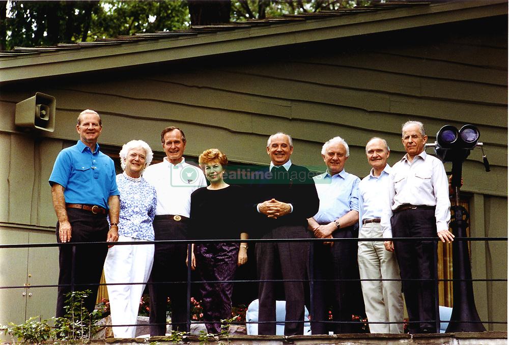 June 2, 1990 - Camp David, Maryland, United States of America - Camp David, Maryland - June 2, 1990 -- (Left to right):  James A. Baker, III, United States (U.S.) Secretary of State; U.S. first Lady Barbara Bush; U.S. President George H.W. Bush; Union of Soviet Socialist Republics (U.S.S.R.) first lady Raisa Gorbachev; U.S.S.R. President Mikhail Gorbachev; U.S.S.R. Foreign Minister Eduard Shevardnaze; U.S. National Security Advisor Brent Scowcroft; and U.S.S.R. Marshal Sergei Akhromeyev pose for a group photo during their visit to the presidential retreat Camp David, Maryland on June 2, 1990..Credit: White House via CNP (Credit Image: © White House/CNP/ZUMAPRESS.com)