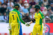 50 - David Warner of Australia celebrates scoring a half century and is congratulated by Usman Khawaja of Australia during the ICC Cricket World Cup 2019 match between Afghanistan and Australia at the Bristol County Ground, Bristol, United Kingdom on 1 June 2019.
