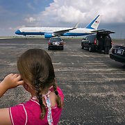 Elianna Olive, 8, from Stilwell, Kan., held her ears closed with the jet engine noise from Air Force Two carrying Vice President Joe Biden during his visit to Overland Park on Thursday afternoon. The U.S. 69 project Biden came to see is getting an infusion of more than $80 million in federal stimulus funds so it can be widened to three lanes in each direction.