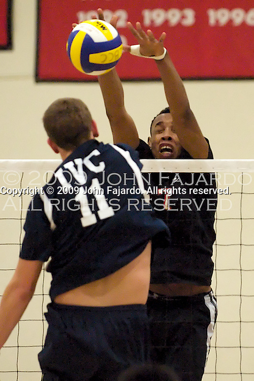 13Feb09 Long Beach, CA-  LBCC Hitter Fidelix Ojo blocks the attack by Taylor Galliano.  LBCC wins at home against Irvine Valley College in three straight sets.