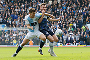 Blackburn Rovers Richard Smallwood tangles with Leeds United midfielder Stuart Dallas (15)  during the EFL Sky Bet Championship match between Blackburn Rovers and Leeds United at Ewood Park, Blackburn, England on 20 October 2018.
